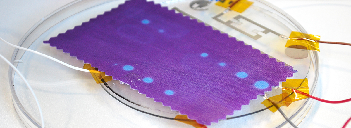 Thermochromicly (heat sensitive) printed textile. The textile is activated with circuits of microheaters, which are electroplated onto a glass wafer.